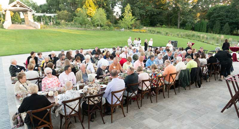 people eating in garden pc John Oates Photography