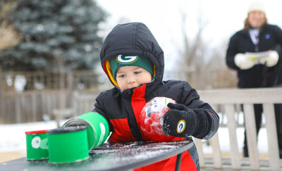 boy playing outside during winter PC Amenson Studio