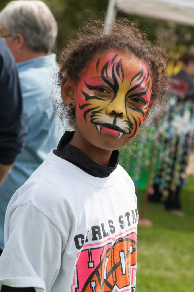 girl with tiger painted face at Fall Family Festival PC John Oates Photography