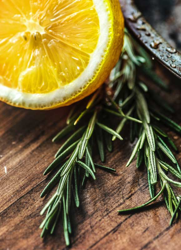 rosemary sprig with half of a lemon