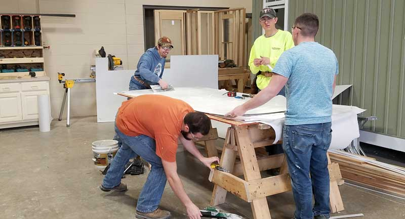 students building ticket shed