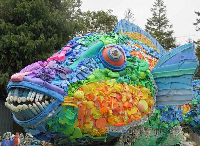 sculpture of priscilla the parrot fish sculpture - blue, orange and purple fish